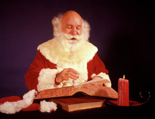 Jolly Holiday Photograph - 1960s Bald Santa Claus Writing Or by Vintage Images