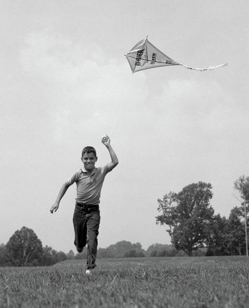 Black Kite Photograph - 1960s Boy Running Flying Kite by Vintage Images