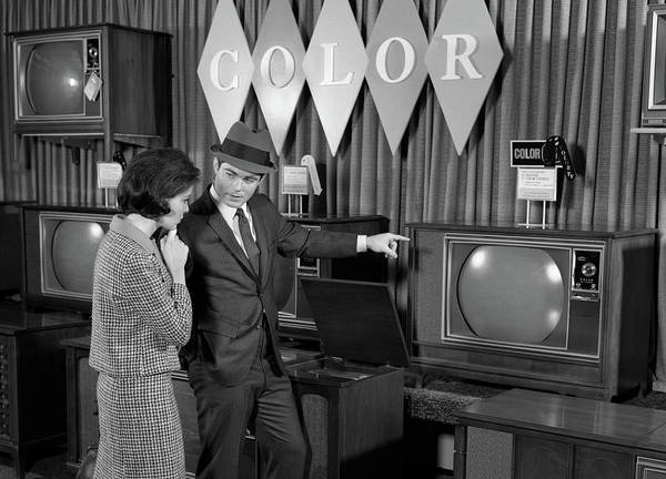 Clothing Store Photograph - 1960s Couple Shopping For Color Tvs by Vintage Images