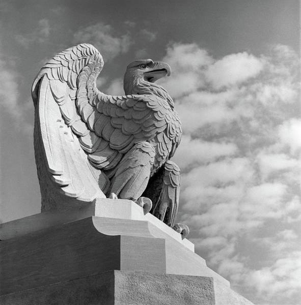 Pennsylvania Station Wall Art - Photograph - 1960s Eagle Statue Against Sky Clouds by Vintage Images