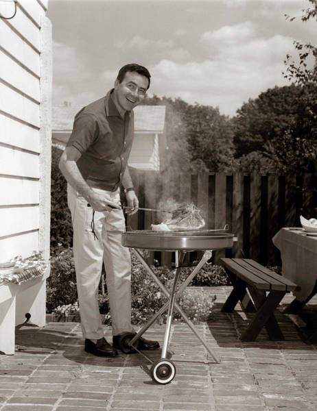 Barbecue Photograph - 1960s Head-on View Of Man Backyard by Vintage Images