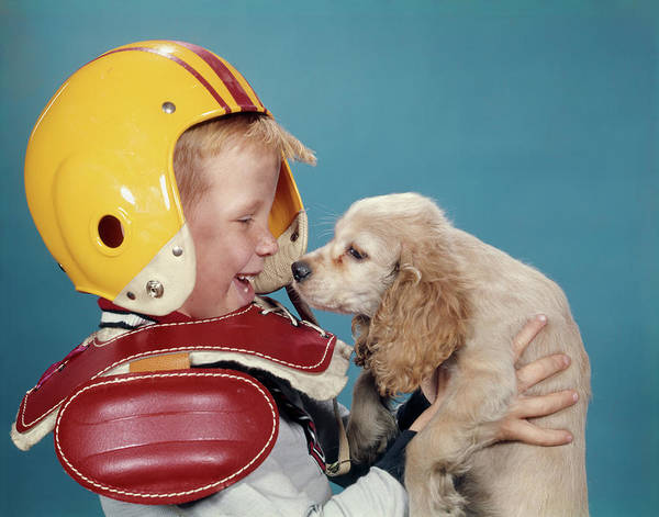 Pet Care Photograph - 1960s Laughing Boy In Football Uniform by Vintage Images