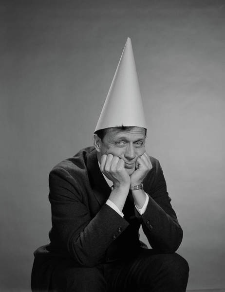 Wall Art - Photograph - 1960s Man Wearing Dunce Cap by Vintage Images