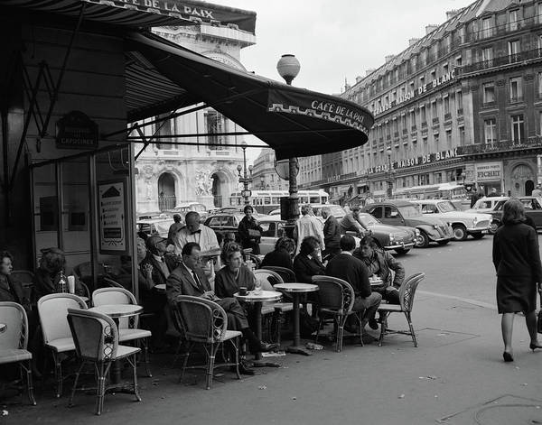 Sidewalk Cafe Photograph - 1960s Patrons At Cafe De La Paix by Vintage Images