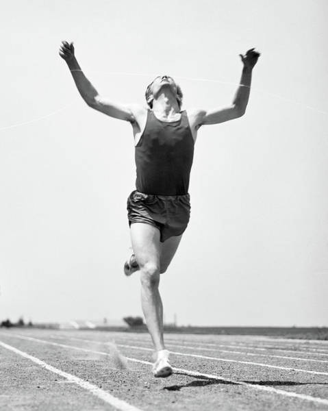 Exertion Wall Art - Photograph - 1960s Runner Straining To Break Tape by Vintage Images