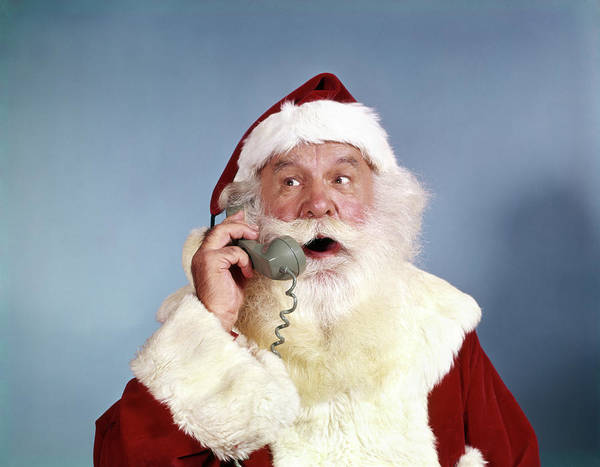Jolly Holiday Photograph - 1960s Santa Claus Talking On Telephone by Vintage Images