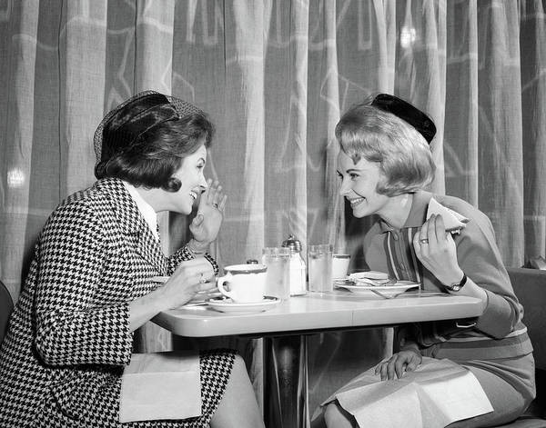Knit Hat Photograph - 1960s Two Women Gossiping At Lunch by Vintage Images
