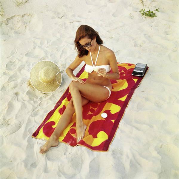 Wall Art - Photograph - 1960s Woman Applying Suntan Sun Screen by Vintage Images