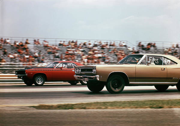 Drag Racing Photograph - 1970s 2 Cars Drag Racing Grandstand by Vintage Images