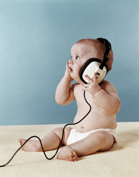 Sensation Photograph - 1970s Baby Listening To Music On Large by Vintage Images