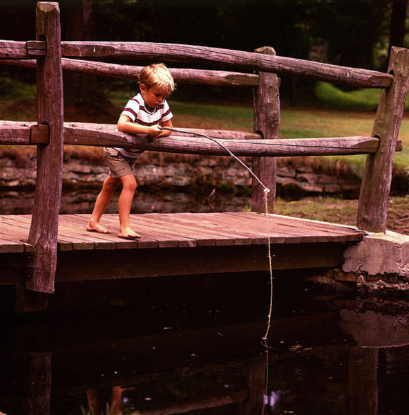 Angling Photograph - 1970s Barefoot Blond Boy Fishing by Vintage Images