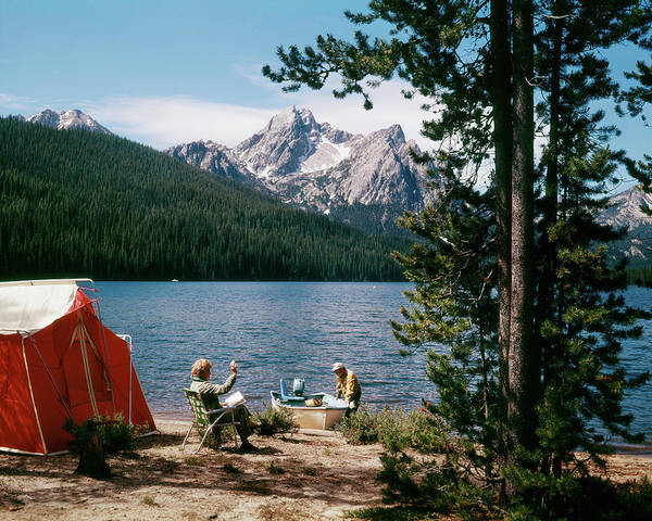 Campsite Wall Art - Photograph - 1970s Couple Camping Stanley Lake, Id by Vintage Images