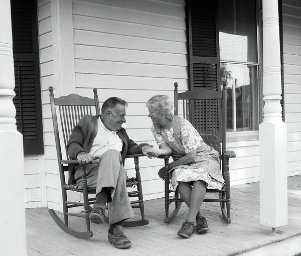 Front Porch Photograph - 1970s Elderly Couple In Rocking Chairs by Vintage Images