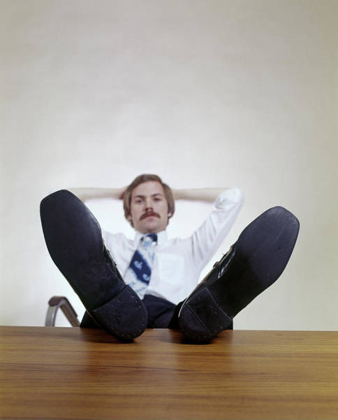 Self Confidence Photograph - 1970s Man Sitting Office Desk Feet by Vintage Images