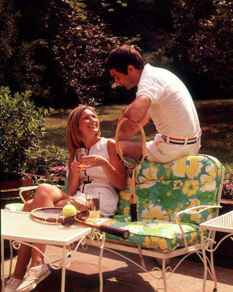Esteem Photograph - 1970s Relaxing Couple Sitting On Patio by Vintage Images