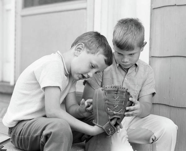 Front Porch Photograph - 1970s Two Boys Seriously Inspecting New by Vintage Images