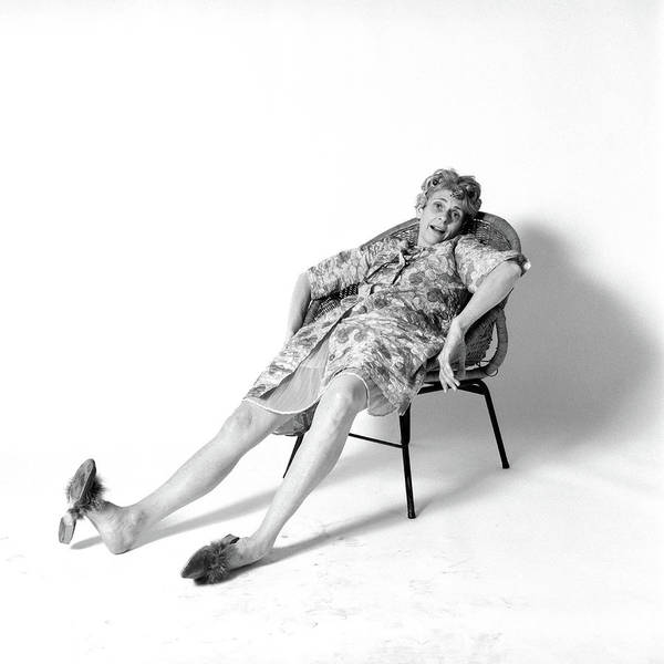 Lady Slippers Photograph - 1970s Woman Slouched In Chair by Vintage Images