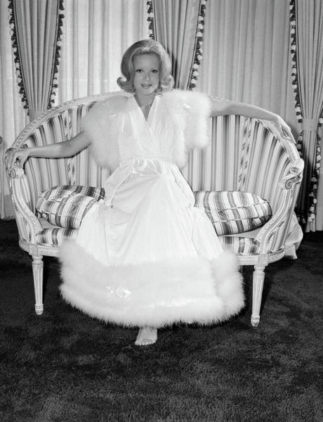 Dressing Photograph - 1970s Woman Wearing White Fur Trimmed by Vintage Images