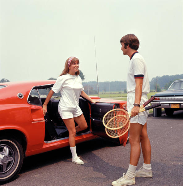 Esteem Photograph - 1970s Young Couple Getting Out Of Car by Vintage Images