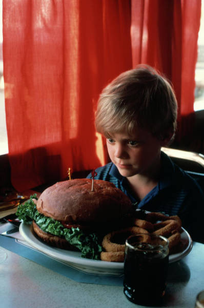 Big Boy Photograph - 1980s Boy Confronted Overwhelmed by Vintage Images