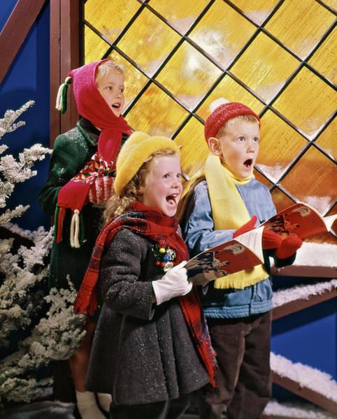 Carol Singing Photograph - 1980s Kids Singing Christmas Carols by Vintage Images