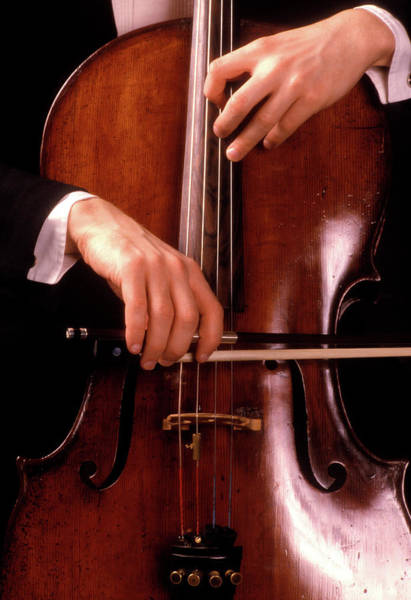Mellow Photograph - 1980s Male Hands Playing Cello by Vintage Images
