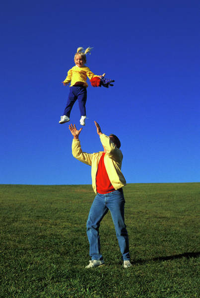 Father Photograph - 1990s Father Tossing Daughter by Vintage Images