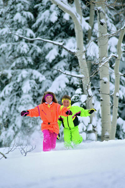 Ski Run Wall Art - Photograph - 1990s Girl And Boy Running In The Snow by Vintage Images
