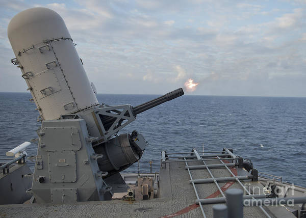 Uss Whidbey Island Photograph - A Close-in Weapons System Is Fired by Stocktrek Images