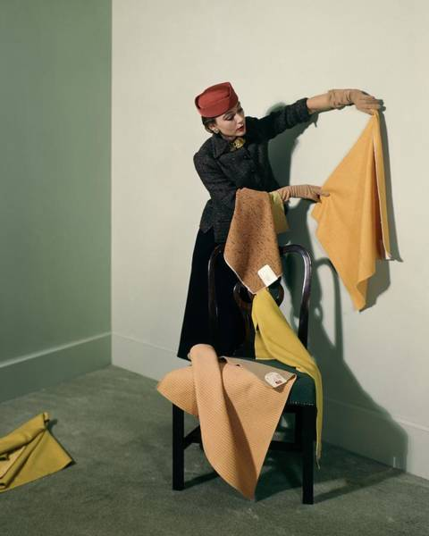 Colorful Photograph - A Woman With Assorted Pieces Of Fabric by Herbert Matter