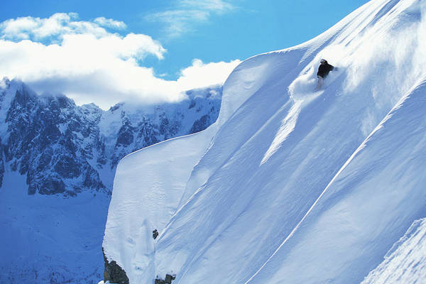 Alpen Glow Wall Art - Photograph - A Young Man Snowboards Down A Steep by Lucas Kane