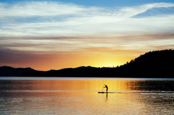 Wall Art - Photograph - A Young Man Stand-up Paddleboards by Keri Oberly