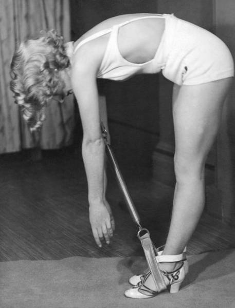 Workout Photograph - A Young Woman Exercising by Underwood Archives