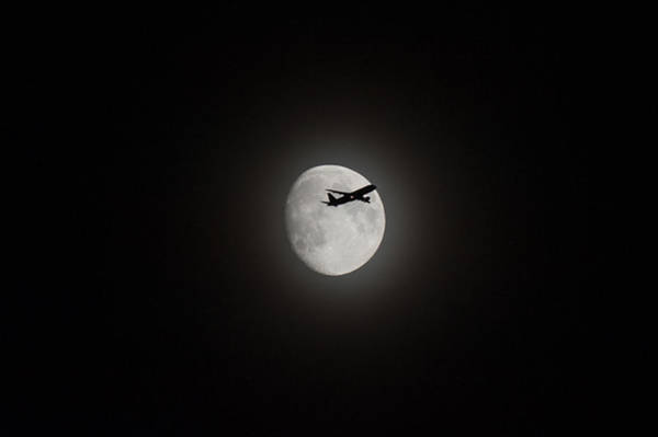 Digital Art - Airliner Passing In Front Of The Moon by Gary Eason
