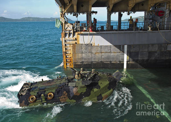 Uss Whidbey Island Photograph - An Amphibious Assault Vehicle Enters by Stocktrek Images