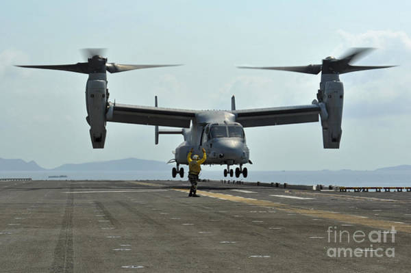 Mv-22 Photograph - Aviation Boatswains Mate Signals An by Stocktrek Images