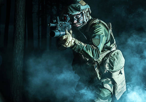 Wall Art - Photograph - Backlit Photo Of A Soldier Moving by Oleg Zabielin