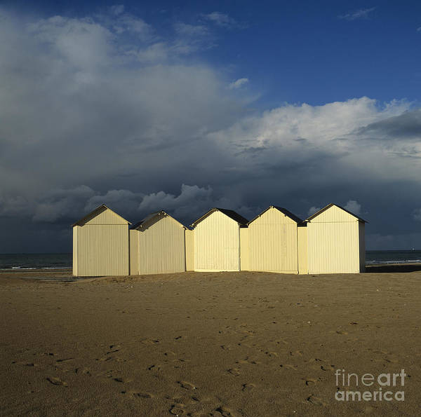 Cabin In The Woods Wall Art - Photograph - Beach Huts Under A Stormy Sky In Normandy. France. Europe by Bernard Jaubert