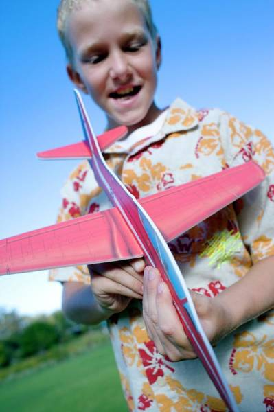 Developed Photograph - Boy Playing With A Model Aeroplane by Ian Hooton/science Photo Library