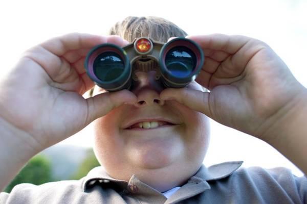 Bird Watcher Photograph - Boy Using Binoculars by Ian Hooton/science Photo Library