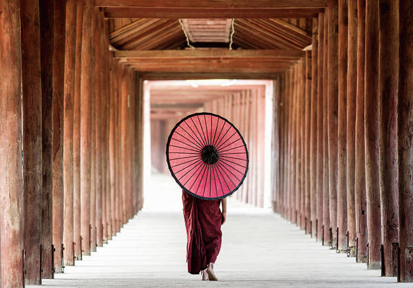 Adolescence Photograph - Buddhist Monk Walking Along Temple by Martin Puddy