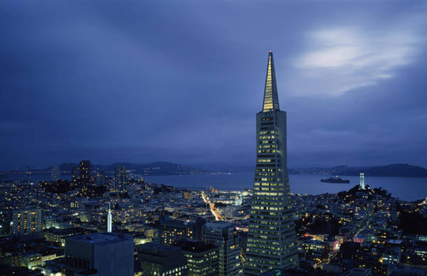 Coit Tower Photograph - Buildings Lit Up At Dusk, Transamerica by Panoramic Images
