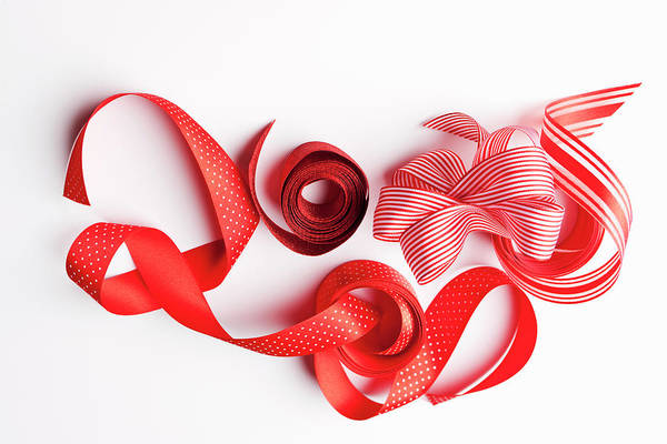 Photograph - Close Up Of Decorative Red Ribbons by Nils Hendrik Mueller