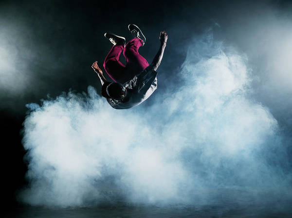 Photograph - Dancer Leaping Through Smoke by Henrik Sorensen