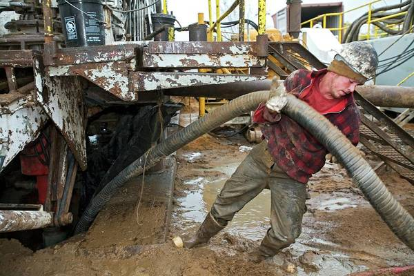 Drilling Photograph - Dismantling A Natural Gas Drilling Rig by Jim West