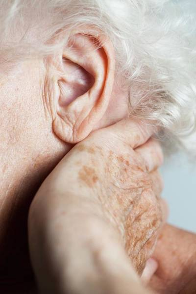 Wall Art - Photograph - Elderly Woman With Neck Pain by Cristina Pedrazzini/science Photo Library