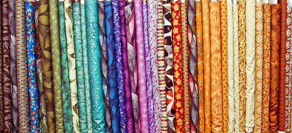 Clothing Store Photograph - Fabric Colours by Tom Gowanlock