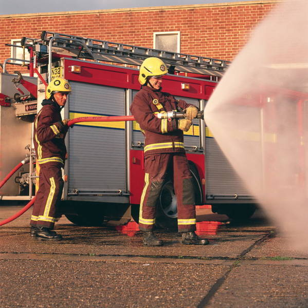 Wall Art - Photograph - Firefighters Using Hose by Simon Lewis/science Photo Library