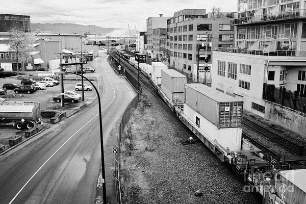Metro Vancouver Wall Art - Photograph - freight train goods tracks near main street and port metro docks Vancouver BC Canada by Joe Fox