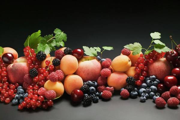 Wall Art - Photograph - Fruit Still Life With Stone Fruit, Berries And Leaves by Foodcollection
